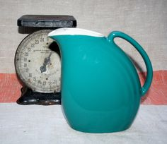 Vintage Hall Pottery Water Pitcher Teal Ice Lip Space Saver Art Deco by AstridsPastTimes on Etsy https://www.etsy.com/listing/247401553/vintage-hall-pottery-water-pitcher-teal