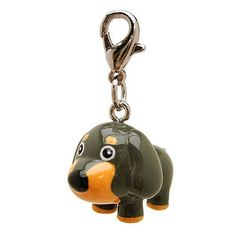 3-D Gray Long Ears Dog Collar Charm by Klippo. Show your love for all dogs with this adorable doggie keychain or collar charm! Split ring clasp 3-D poly Use as keychain or collar charm! This cartoonish character is a perfect addition to your pup's collar! The 3-D Long Ears Dog Collar Charm is a cute 3-D poly dog figurine charm. It can be attached to the small D-ring of an outfit or to a dog collar! A split ring is included with the charm to fit onto a collar.