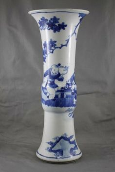 Good Chinese Kangxi (1662-1722) Blue and White Porcelain Vase, of Gu form, with a spreading lip above a continuous scene of mother and child in a garden landscape, double circle mark to base, h 29.5 cm