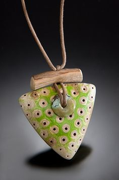 Driftwood, shaped, colored with turquoise bead and cotton cord by Nina Morrow