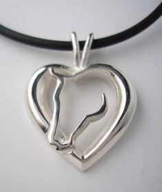 """Sterling Silver Horse Head nestled in Sculpted Heart Pendant. The beautifully designed pendant measures 1-1/8"""" in length including the bail ..."""