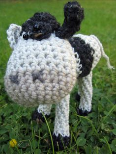Crochet Pattern for Emmental Cow | Emmental's very photogenic; say CHEESE!  She's the best lookin' cow in the herd with one black eye and one white one, one black ear and one white one, a black patch on her head and on her back. Emmental would like a limitless supply of buttercups, a pair of sunglasses . . . oh, and world peace!
