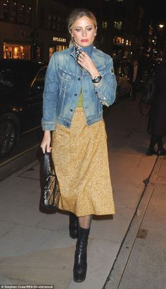 So chic: Laura Bailey wore a denim jacket with a tweed skirt and heeled ankle boots
