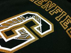 Metallic gold ink with white on a black shirt.  Clean and crisp, just like it should be.  www.visualimp.com
