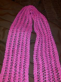 One Row Lace Scarf  http://www.ravelry.com/projects/chrisiw8/one-row-lace-scarf