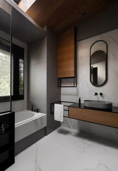 In this modern grey, black, and wood bathroom, curved elements like the mirror and the basin reflect the curved interior shape of the bath. best bathroom decor Chevron Patterns And High Ceilings Can Be Found Throughout This Home In Kiev Interior Design Blogs, Bathroom Interior Design, Interior Design Inspiration, Design Ideas, Design Trends, Design Fails, Restroom Design, Design Styles, Interior Paint