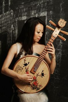 The ruan is a Chinese plucked string instrument.Its strings were formerly made of silk but since the century they have been made of steel. The modern ruan has 24 frets with 12 semitones on each string. Ukulele, Homemade Musical Instruments, World Music, Sound Of Music, Playing Guitar, Music Stuff, Cello, Music Lovers, Musicals