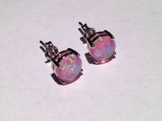 Amazeballs pink fire opal earrings that reflect different colors!