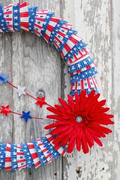 Outdoor 4th of July Decor • Great ideas and Tutorials! Including how to make this cute cupcake liner wreath from ehow.