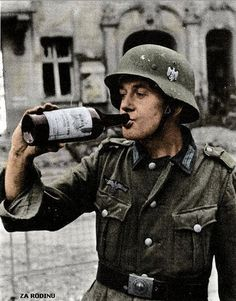 'Spoils of War' German soldier drinks some 'Juice' after a bombing raid in Berlin, August 1943