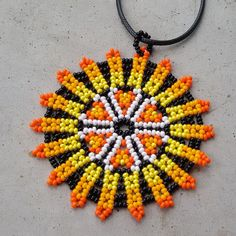 sun necklace Huichol Sunflower pendant Mexican Necklace inspired by native american Boho necklac sun necklace Huichol Sunflower pendant Mexican Necklace inspired by native american Boho necklac Native Beadwork, Native American Beadwork, Beaded Jewelry Designs, Seed Bead Jewelry, Beaded Tassel Earrings, Boho Necklace, Bead Loom Patterns, Beading Patterns, Handmade Beads