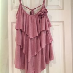 Adorable Mauve Ruffled Top Ruffle mauve top. This is a very feminine top that is perfect for a night on the top. Looks amazing paired with skinny jeans, heels, and a slim leather jacket. Or perfect for a summer evening. 57% polyester 38% rayon 5% spandex Tops Blouses