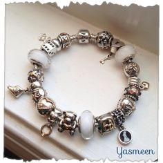 This simple yet sentimental bracelet tells the story of my family and me. Yasmeen