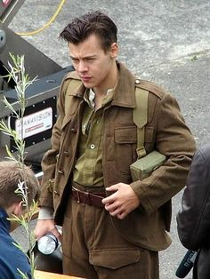 Harry Styles is ready for combat.  The One Direction member was spotted donning British World War II military dress – and his new short haircut! – while on the set of his new movie, Dunkirk.  The upcoming film from writer and director Christopher Nolan tells the true story of the evacuation of the French