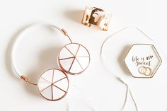 Taylor Headphones with interchangeable cap sets. Featuring a genuine mother of pearl option with rose gold accents.