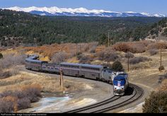 Amtrak's westbound Southwest Chief climbs Raton Pass at Wootton, Colorado, on March 6, 2005. Two deadhead Superliner cars up front make for a strange looking train…