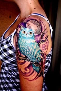 Beautiful blue owl watercolor tattoo on arm for girls