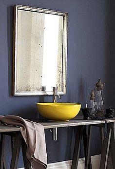 Fun bright yellow sink in a grey monochromatic bathroom.