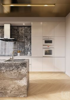 Sleek SieMatic cabinets play off natural and metallic textures in this luxurious Moscow apartment.