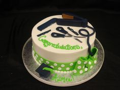 A delicious buttercream graduation cake with a green polka dot ribbon and bow. Party Flavors Custom Cakes.