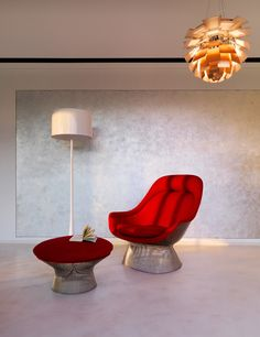 """In 1966 the Platner Collection captured the """"decorative, gentle, graceful"""" shapes that were beginning to infiltrate the modern vocabulary. The Platner Easy Chair is created by welding hundreds of curved, nickel-plated steel rods to circular frames, simultaneously serving as structure and ornament."""