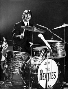 4-Ringo Starr grins while playing the drums during the Beatles' performance on the Ed Sullivan Show in February 1964.