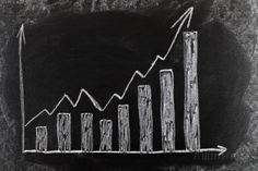 Business Chart on Blackboard Showing Increase in Sales Photographic Print by olechowski at AllPosters.com