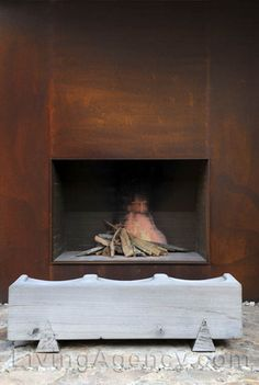 rusted metal fireplace Consider copper instead? Modern Outdoor Fireplace, Metal Fireplace, Fireplace Hearth, Stove Fireplace, Living Room With Fireplace, Fireplace Surrounds, Contemporary Fireplace Designs, Interior Cladding, Chalet Design