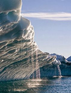 Melting Water Streams from iceberg in Disko Bay, Greenland - Explore the World with Travel Nerd Nici, one Country at a Time. http://TravelNerdNici.com
