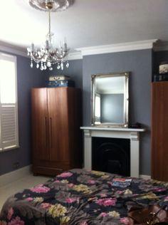 Dreamy bedroom, grey walls, chandelier, oak wardrobes, silver gilt mirror, shutters