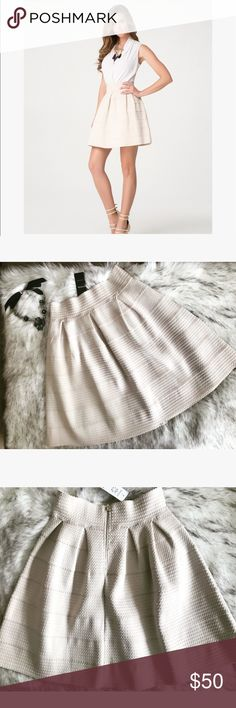 💝 Bebe textured skirt 💝 ⚡️Brand NEW⚡️ Gorgeous flare textured skirt in cream color ⚡️ this skirt is absolutely stunning and it can be paired with any color cropped top ⚡️💝 very stretchy it can probably fit medium as well 💝 bebe Skirts Mini