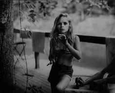 sally mann, is an amazing photographer who still works with dying photo processes! <3 LOVE HER WORK!