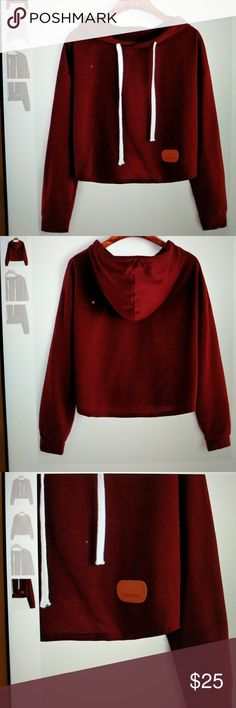 Deep Red Patch Crop Hooded Sweatshirt NEW New without tags, super cute cropped Red Hooded Sweatshirt. Ordered two by mistake selling one instead of shipping it back. Super light, perfect for Spring, Summer and fall or early morning jogs. One-Size. Tops Crop Tops