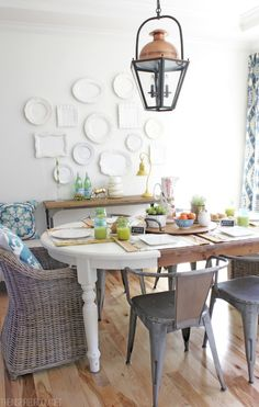 Spring dining room with white plate wall and copper lantern