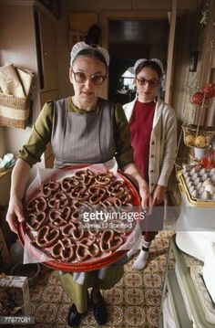News Photo : A Amish woman displays a tray of chocolate...