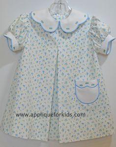 Collar, armbands & pocket from: www.appliqueforkids.com Dress pattern is Children's Corner - Carol