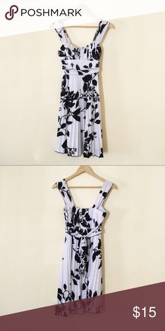 Black and white cocktail dress Black and white floral dress. Pleat details on skirt, ties in the back. Padded. Good condition. Dresses Midi
