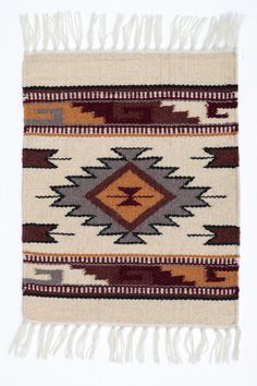 "Receive (1) Maya Modern Mat. Handwoven of imported 100% Wool in popular Zapotec styles and rich colors.  These newly-designed Maya Modern Table Mats add a touch of classic Southwest decor to any room.  Imported.  Apx. 15"" x 20"""