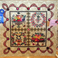 """""""Good and Plenty"""", 52 x 52, by Jan Soules, quilted by Debbie Lopez. Four blocks based on the 19th century Mary Simon quilt top. Photo by Quilt Inspiration."""