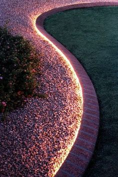 Use rope lighting to line your garden.  It's waterproof, and you can put it on a timer.  You could also use a border of rocks to separate the lawn from the deck.   |   Backyard hack