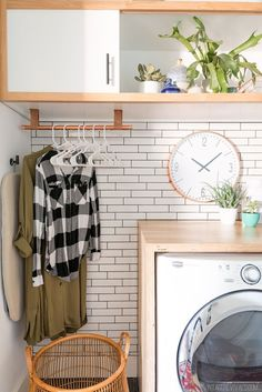 This gorgeous DIY Laundry Room Makeover has such great ideas including how to make a waterfall countertop and the beautiful copper hanging clothes rack. | Vintage Revivals #diyhomereno #diylaundryroom
