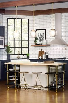 Modern kitchen with gold features, and white tile to the ceiling
