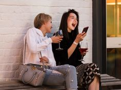 laughing friends drinking wine