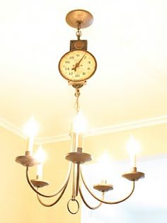 LOVE this idea. Hang the chandelier off of an old scale! Brilliant. :)