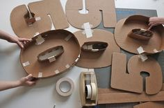 maybe do each letter to look different. one can have large screw heads,,,look like metal...one wood...one fancy font,,,