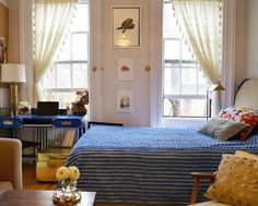 Pretty blue bedding with punchy pillows and gauzy curtains
