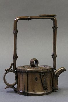 Chinese Ceramic Tea Pot, of faux bamboo form 'nailed' with reinforcements, the recessed base marked 'Yang Chun[rong]'