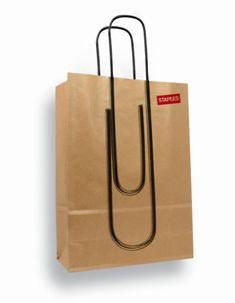 Torba papierowa, ilustracja i rączki sprawiają wrażenie spinacza przyłączonego do torby