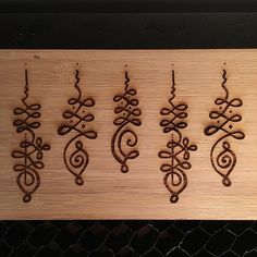 Clear Cut Creation — Unalome designs being etched into bamboo ...