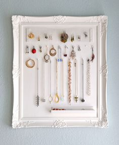 Use an old/unwanted picture frame to hang and organize your jewelry.